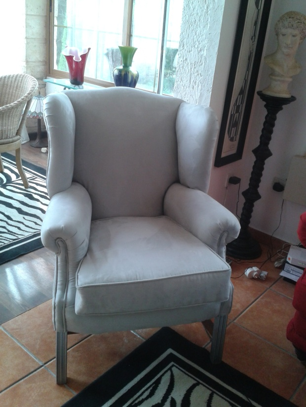 Upholstered chair in grey faux suede