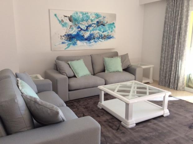 Contemporary print curtains, grey linen sofa , Art by Zavier